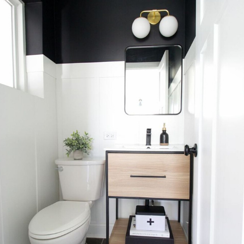 A bathroom with a white counter  Description automatically generated