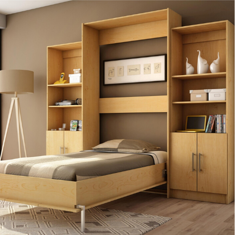 A bedroom with a bed in a room  Description automatically generated